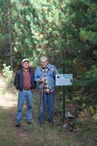 Volunteer conservation easement monitor Bill Reardon (left) with landowner Don Kratsch.